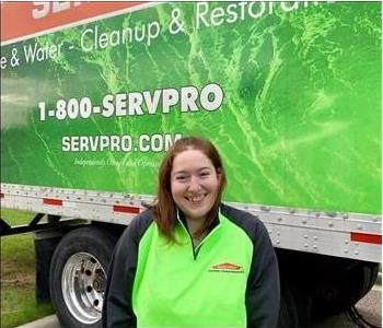 Female SERVPRO smiling in front of SERVPRO semi