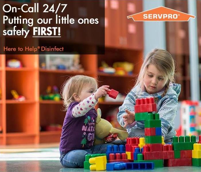 Picture of two girls playing in a daycare with SERVPRO logo