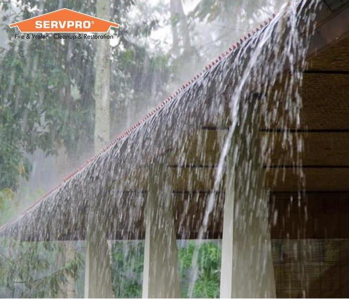 Heavy rain on roof with SERVPRO logo
