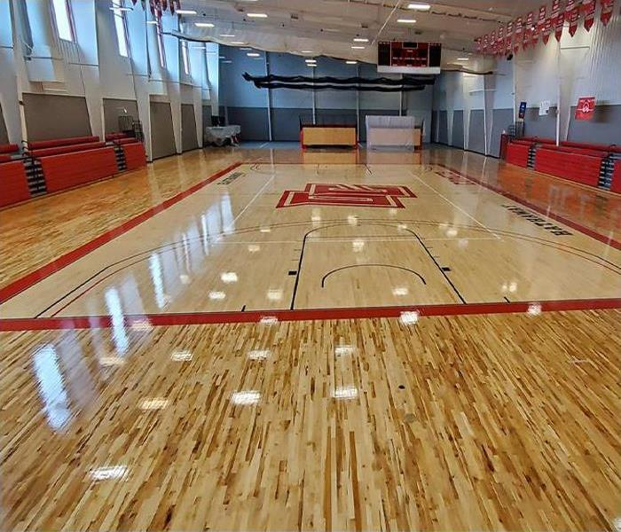 Gym floor after being completely replaced from water damage
