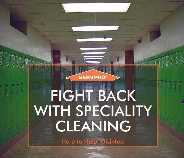 Empty school hallway with SERVPRO logo