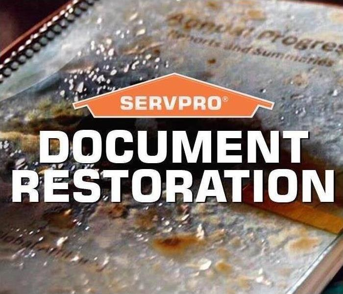 Close up of documents with SERVPRO logo