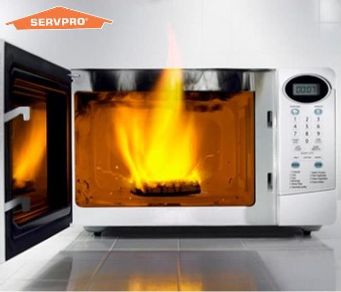 Microwave on fire with SERVPRO logo