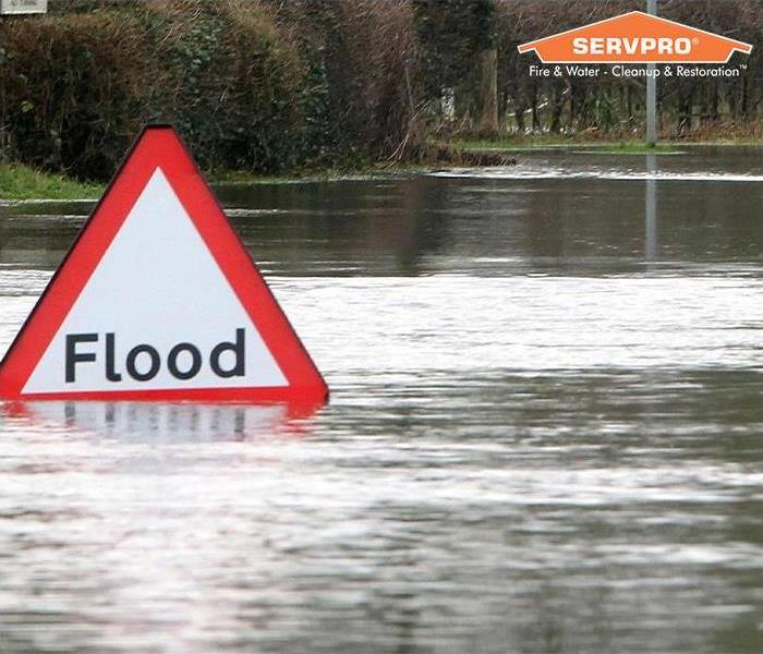 Flooded area with flood sign and SERVPRO logo