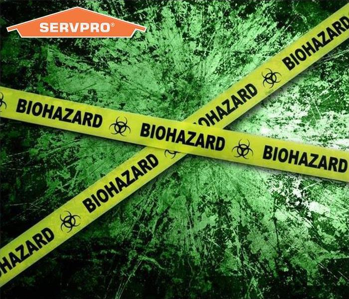 Biohazard yellow tape with green background and SERVPRO logo